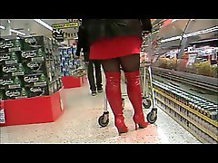 Red boots black tights  and a red mini dress