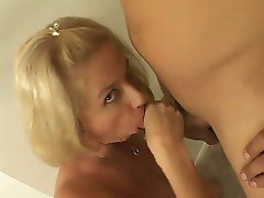 Big tit blonde blowing a hard cock