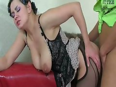 Brunette milf in curlers gets nailed by young cock