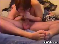 Asian girlfriend blowing a cock in home video