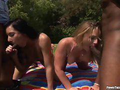Flower Tucci and her girlfriend take turns blowing a throbbing dick