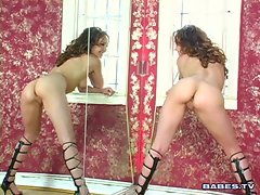 Cytherea poses in her sleek high boots with her wet pussy dripping