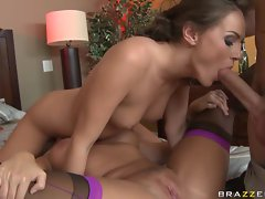 Hot Tori Black enjoys blowing a meaty pole on a threesome action