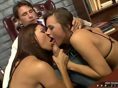 Two horny girls, Ann Marie and Tori Black, alternate blowing a big cock