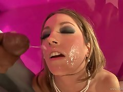 Jenna Haze gets her face sprayed with warm cock juice