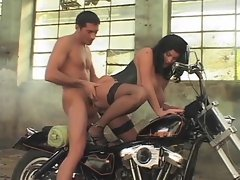 Big titted babe is stuffed on a motorcycle