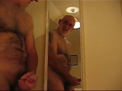 Master Wanker wanking in front of a mirror