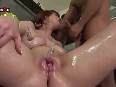 Kinky redhead blowing up her pussy with a pump