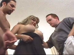 Blonde milf takes two hard cocks