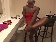 Ebony pole dancer uses feet to jack him off