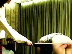 Watch a rough and painful caning