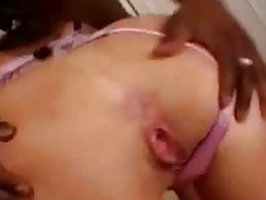 Girl blowing a black cock and taking a facial