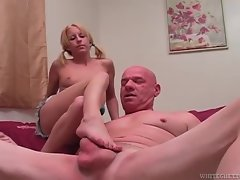Horny pigtailed blonde cutie massaging older mans cock with her feet