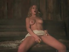 Busty blonde babe using her dildo in the sauna