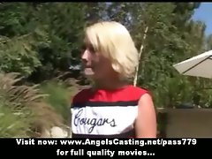 Charming tempting luscious light-haired cheerleader training outside