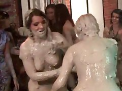 Topless mud wrestlers show dirty hooters